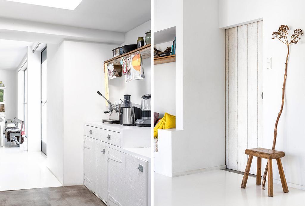 Wit herenhuis met witte keuken en een berenklauw