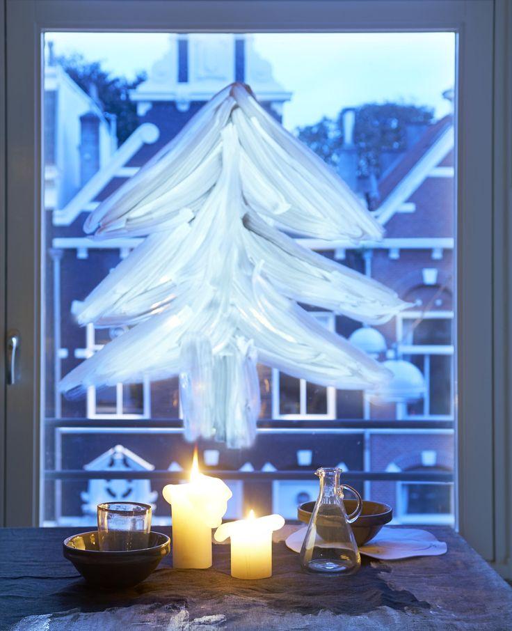 duurzame kerstboom op het raam tekenen