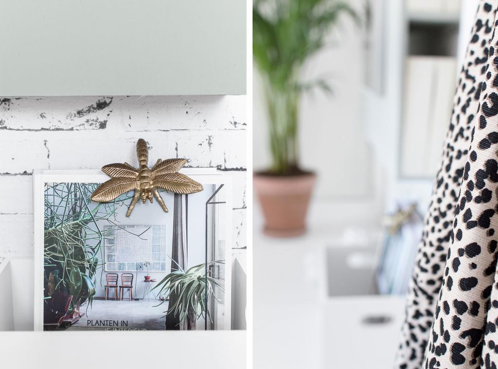 Opbergbox boek over planten en panterprint in slaapkamer
