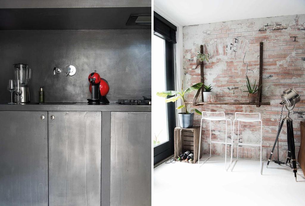 Industriële keuken met een bakstenen wand en een bar