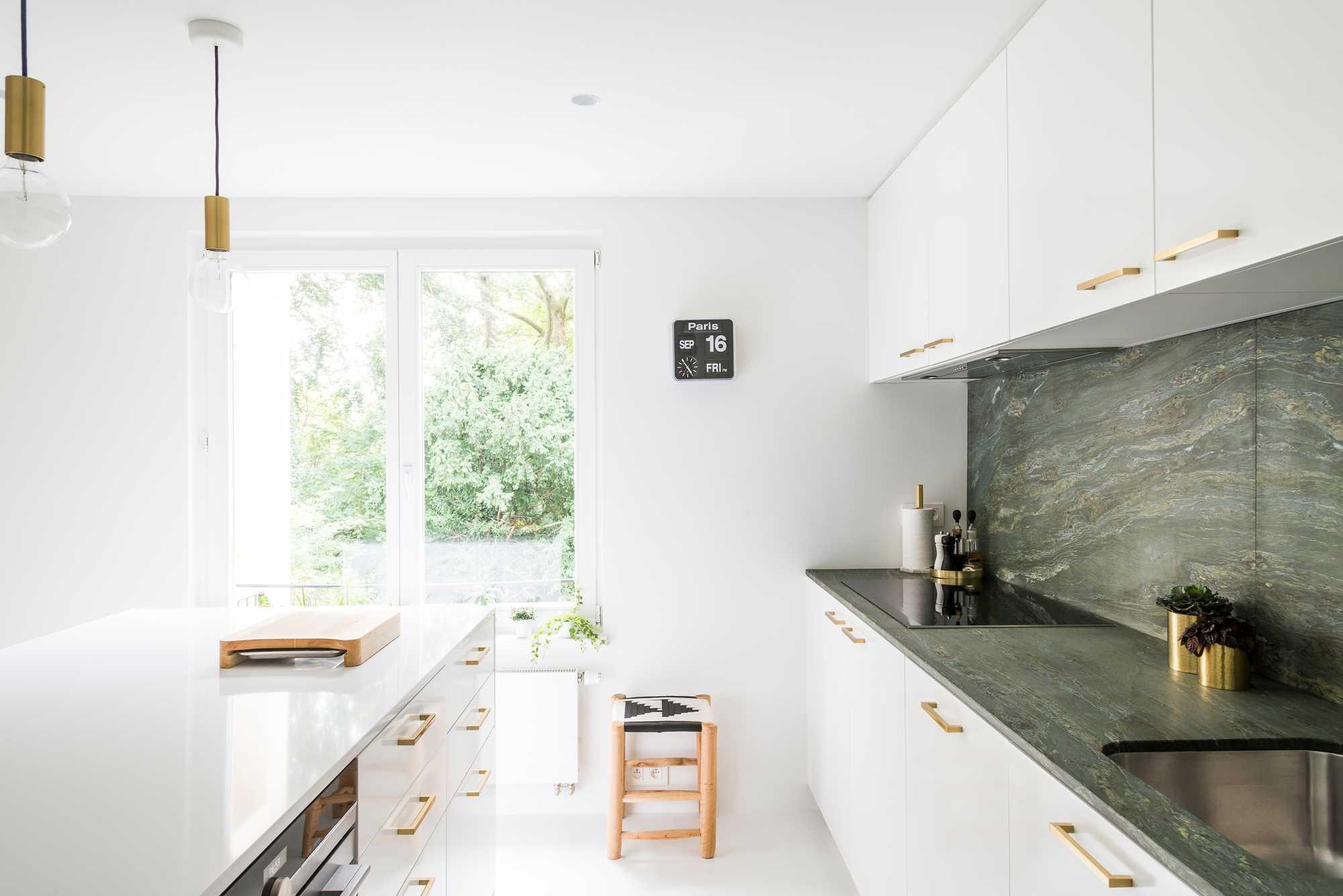 keuken kookeiland spatwand