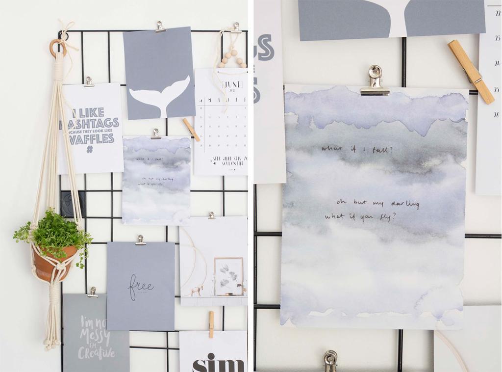 Posters uit het posterboek aan een memobord