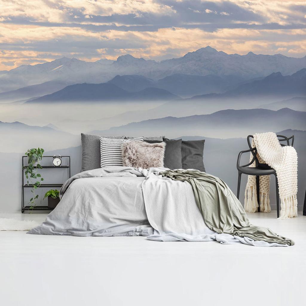 fotobehang bergen met mist en wolken