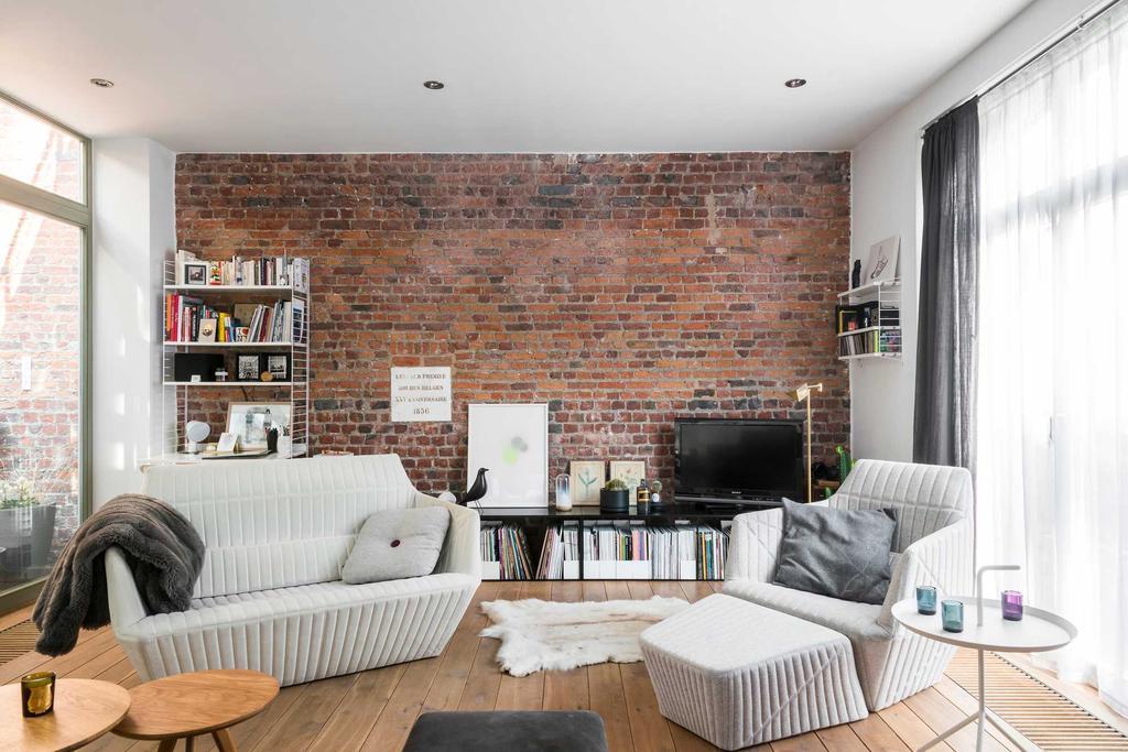 loft brussel baksteen muur