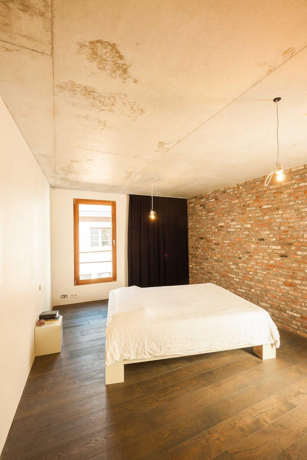 slaapkamer bed baksteen