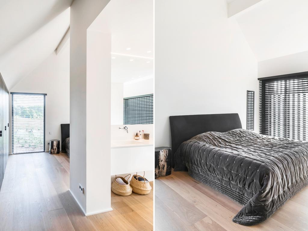 bk slaapkamer met badkamer in zwart en wit
