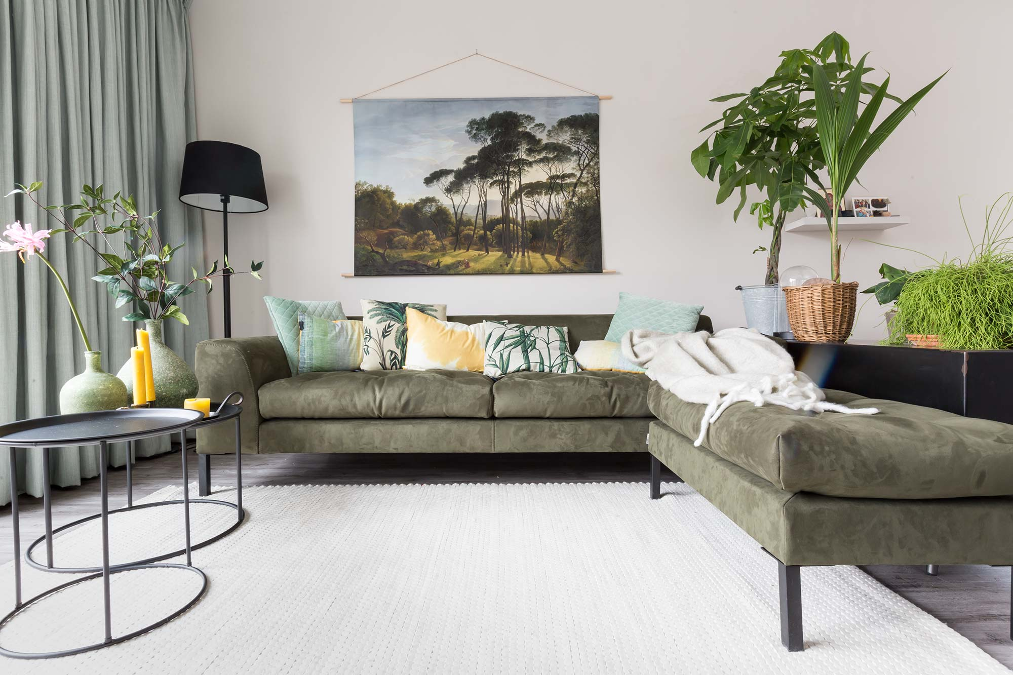 Groene zithoek met loungebank