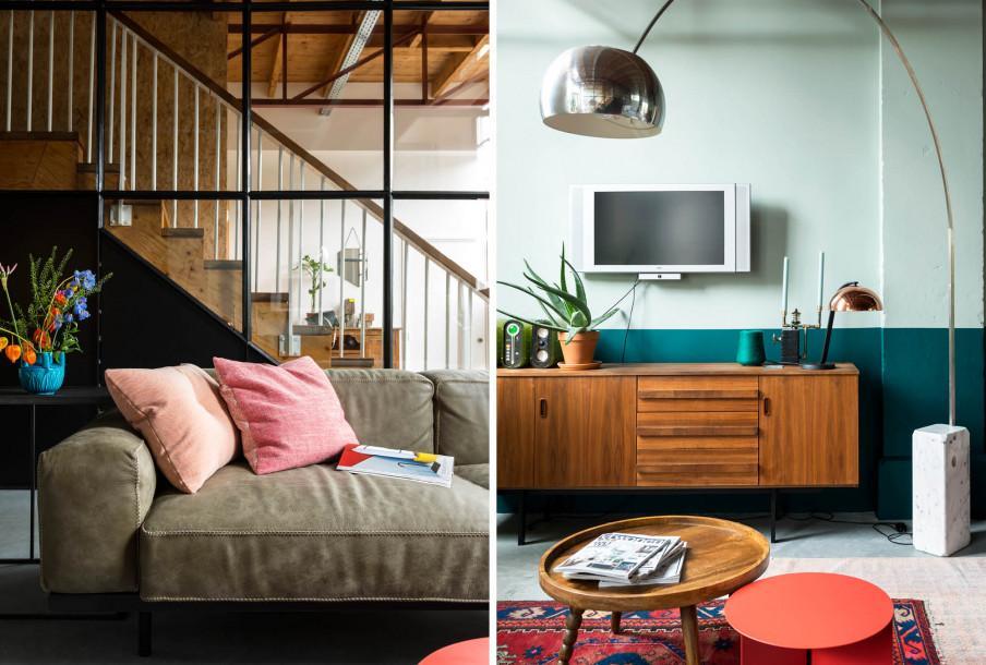 Canape devant escalier et meuble tv avec mur blanc et vert
