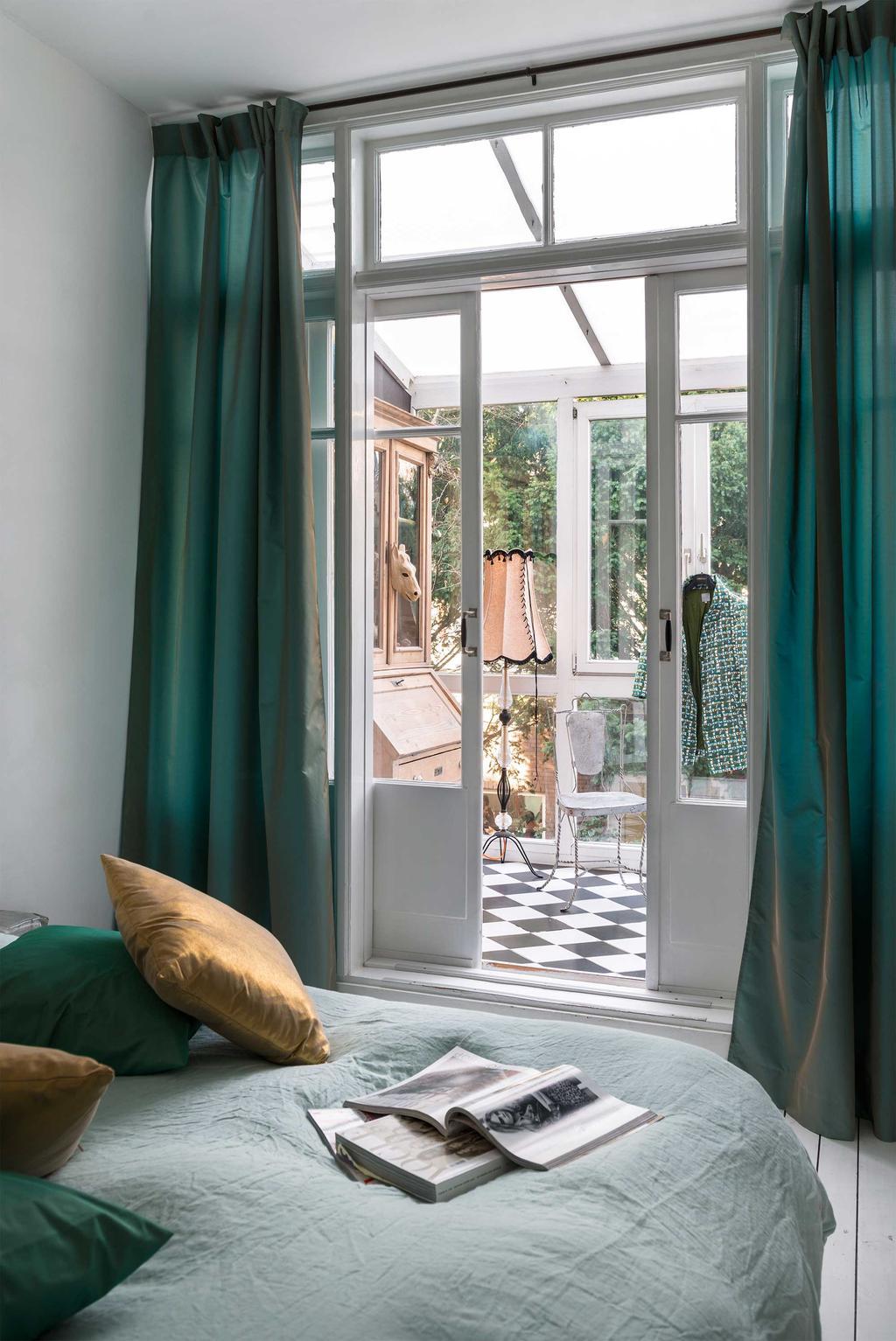 slaapkamer groene gordijnen serre