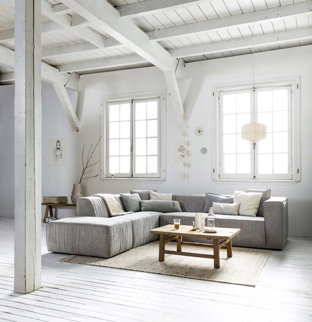 Bij het indelen van de woonkamer helpt het om veel licht naar binnen te laten komen
