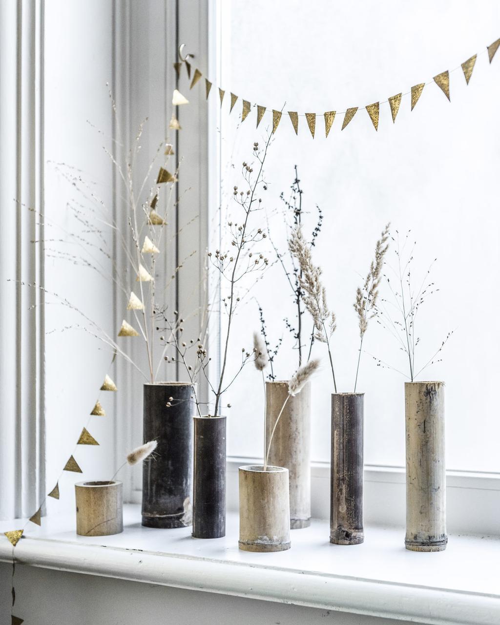 DIY: zet je mooiste veren, bloemen en takken in deze zelfgemaakte bamboevaasjes met de DIY uit de feest special.